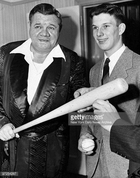 Babe Ruth poses with Boy Scout Harvard Hodgkins. Hodgkins and his family were flown to New York for his role in catching the spies. He was given the keys to the city, and an autograph from the baseball legend. (Getty Images).