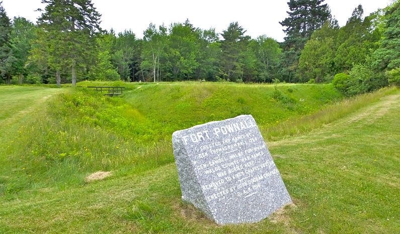 The stone marker and some of the earthworks of the fort