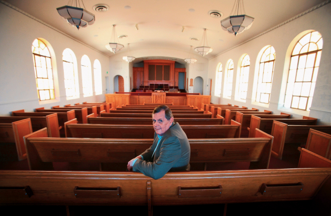 Robert Dinsmoor, Public Relations Official for The Church of Jesus Christ of Latter-day Saints in El Paso, sits in the chapel after renovations were completed. Courtesy of El Paso Times