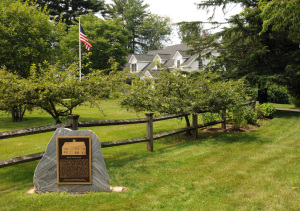 Smith Homestead Marker located where home once stood with the Rossano Estate in background