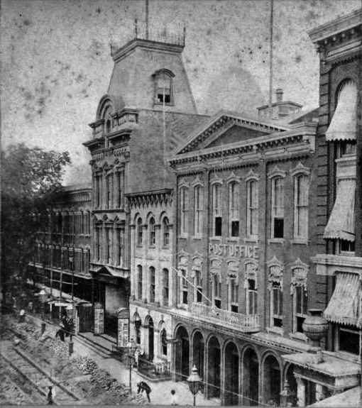 The theater prior to its destruction-the theater is the building with the large mansard roof to the left of the post office.