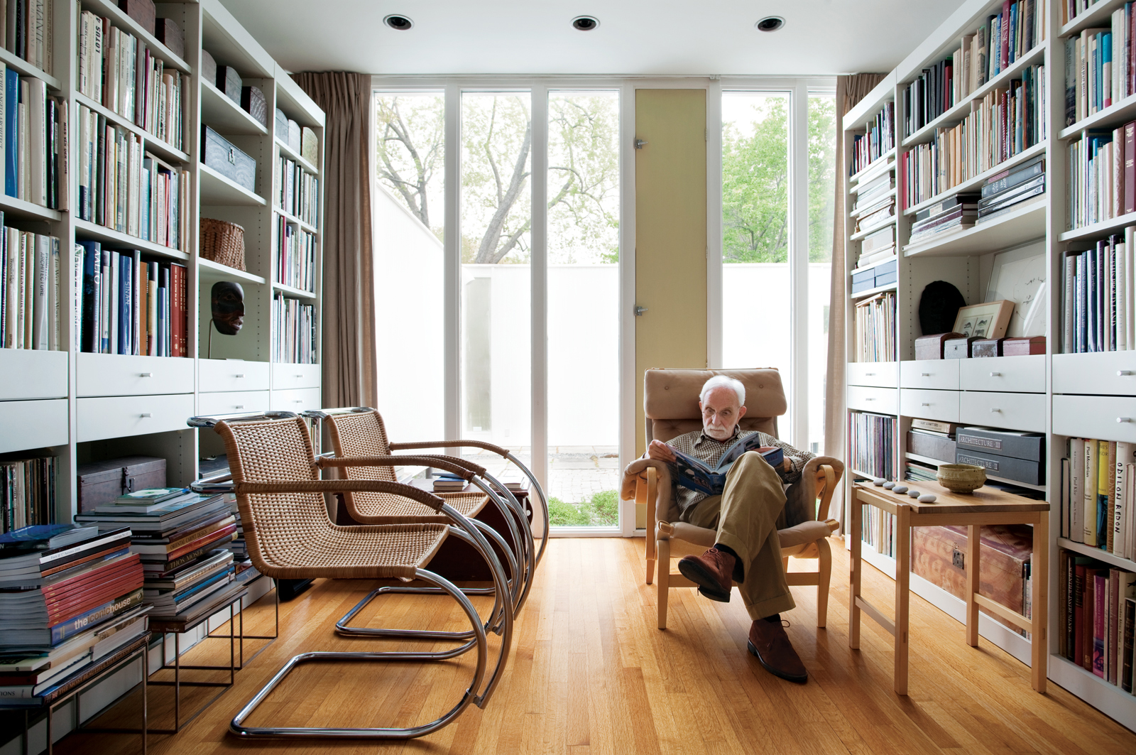 Philip Isaacson reading in his library. Photo Credit: Eric Roth
