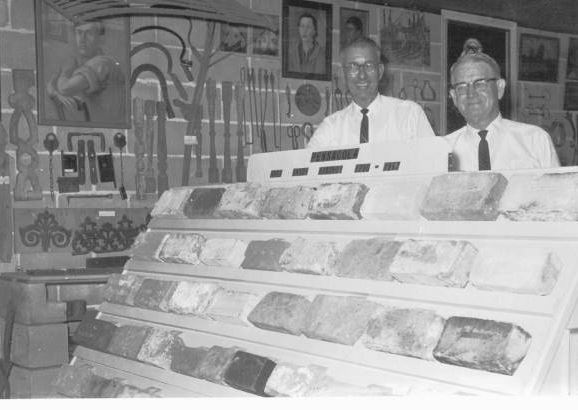 W.D. Donaldson and T. T. Wentworth Jr. standing with a brick collection which dated back to the 1600s at the museum.