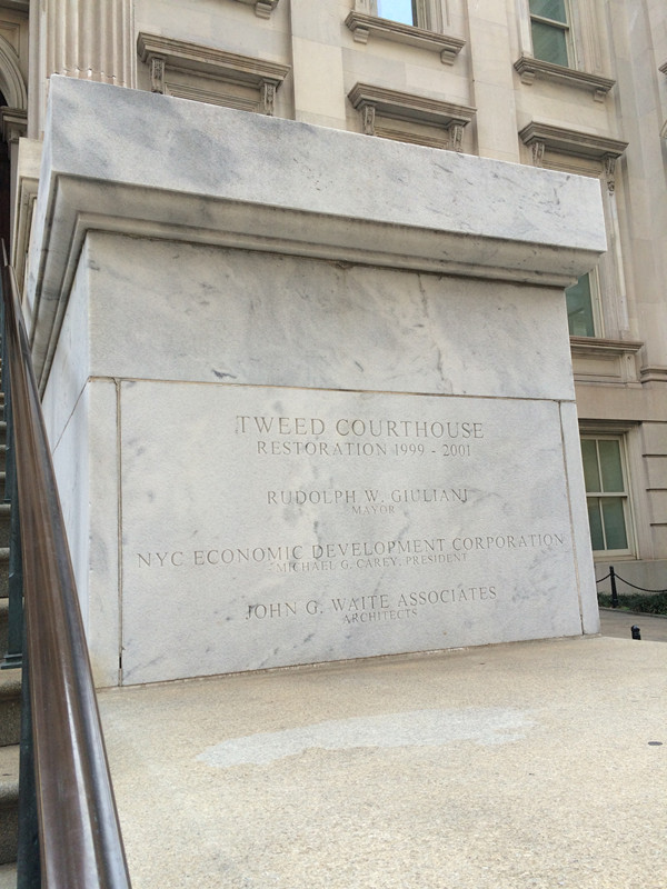Stone indicating the restoration of the Tweed Courthouse.
