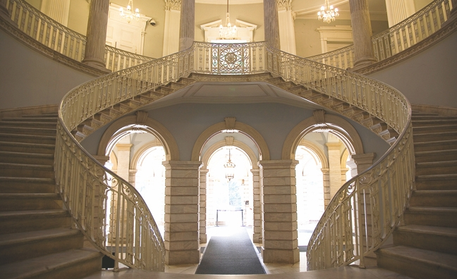 The grand staircase leading to the second floor.