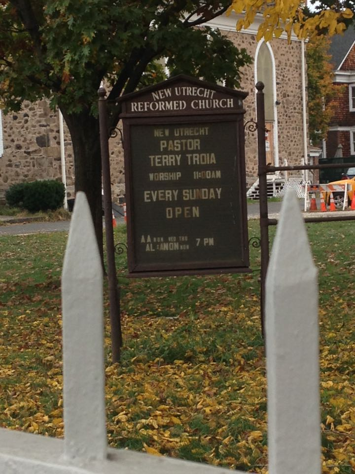 Sign in front of church -- Service days