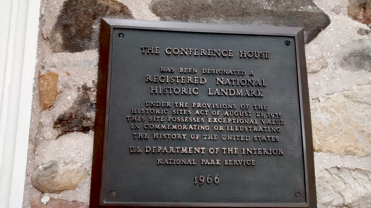 A plaque showing that the house is a national historical landmark.