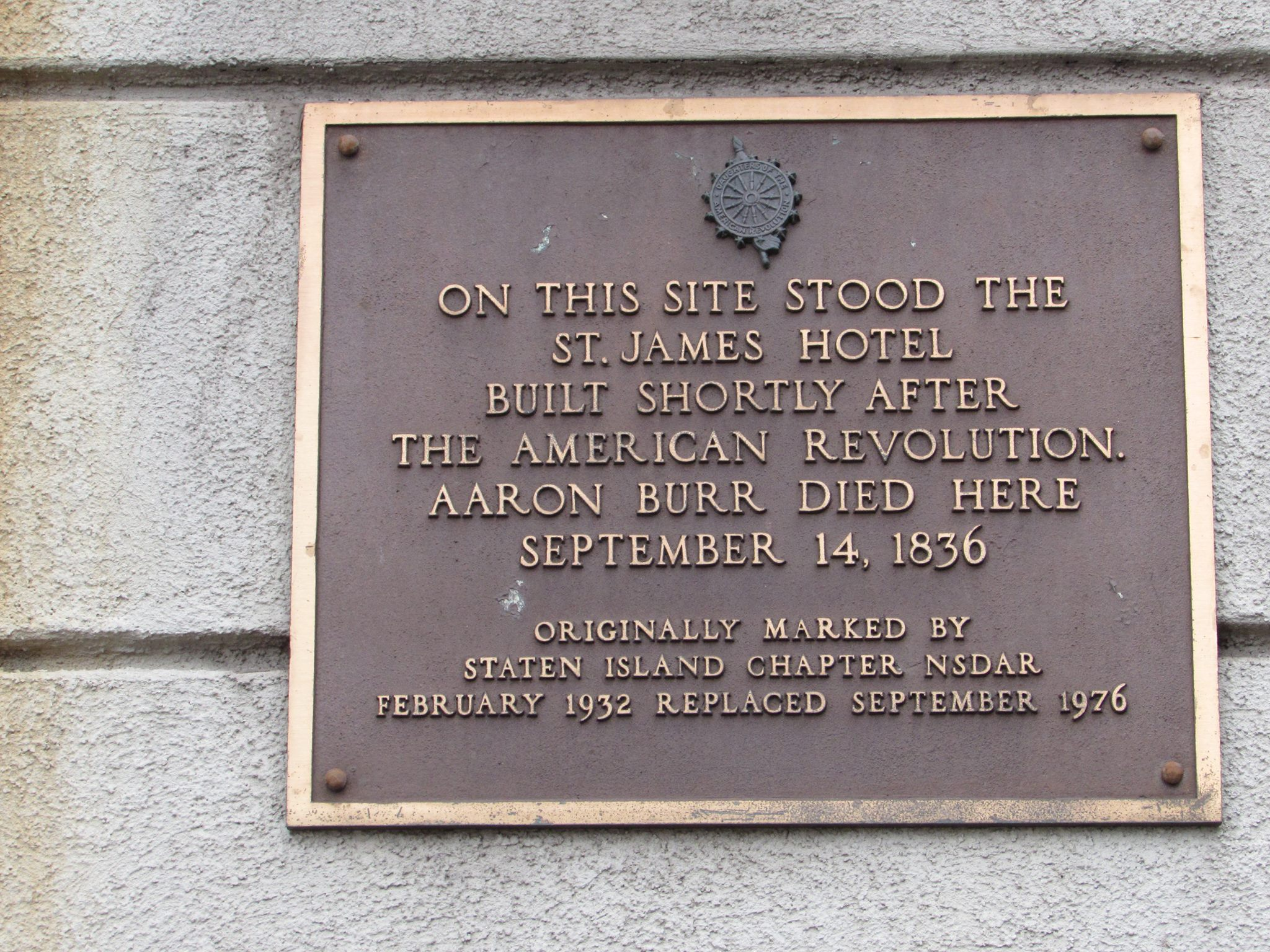 This is a plaque on the front of the apartment building that marks the old St. James Hotel and the death of Aaron Burr Jr.
