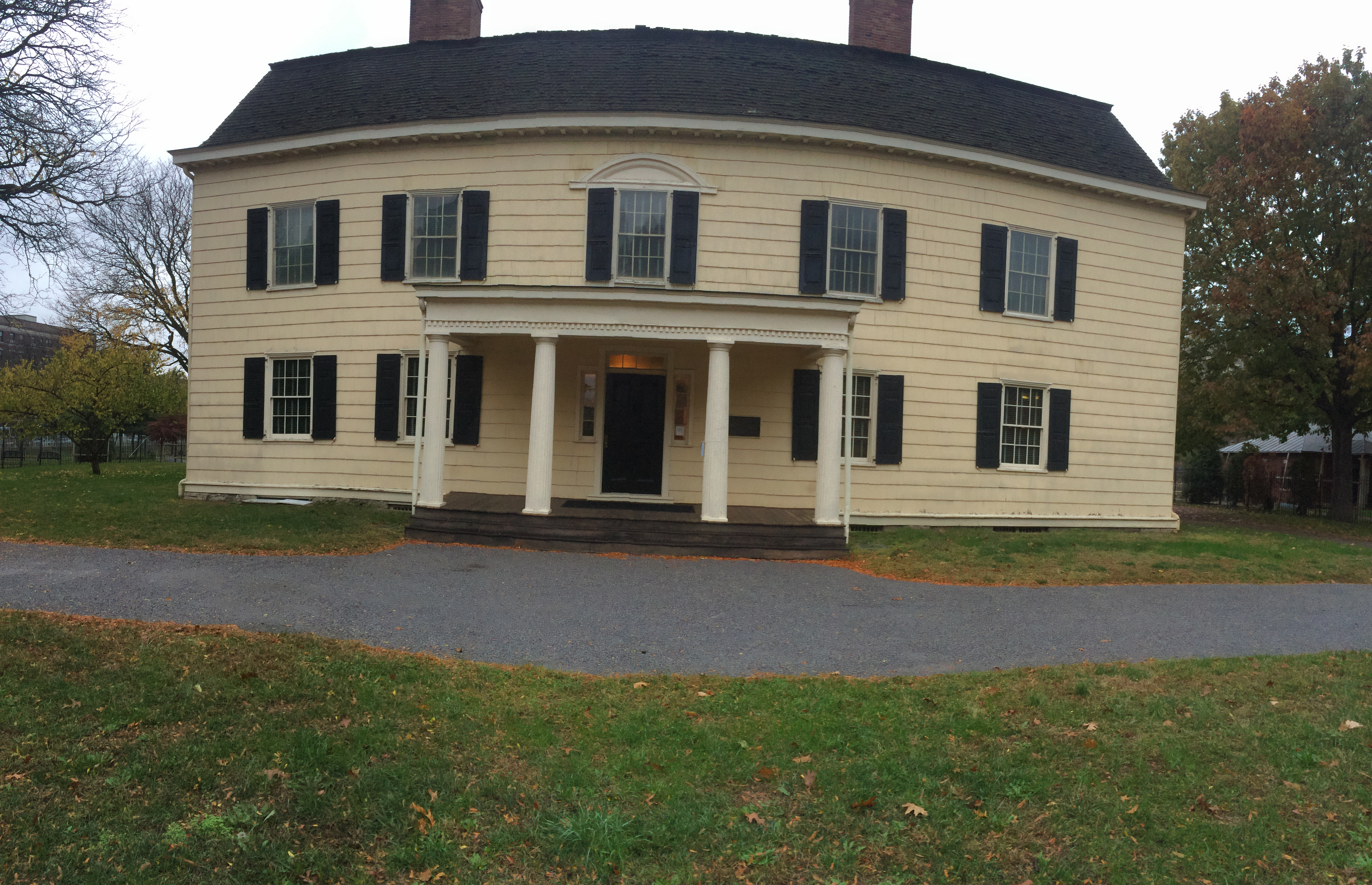 This picture is a panoramic frontal view of King Manor Museum.