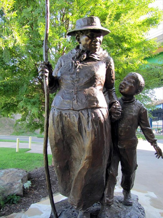 This sculpture of Harriet Tubman was one of several statues commissioned and dedicated in 2004 as part of a walkway between the River Market and Clinton Library.
