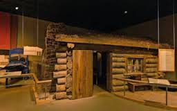 "A reconstructed hut inside visitor center to show what a ""house"" at the camp would have looked like."