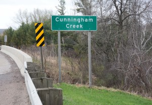 Sign and bridge over over Cunningham Creek