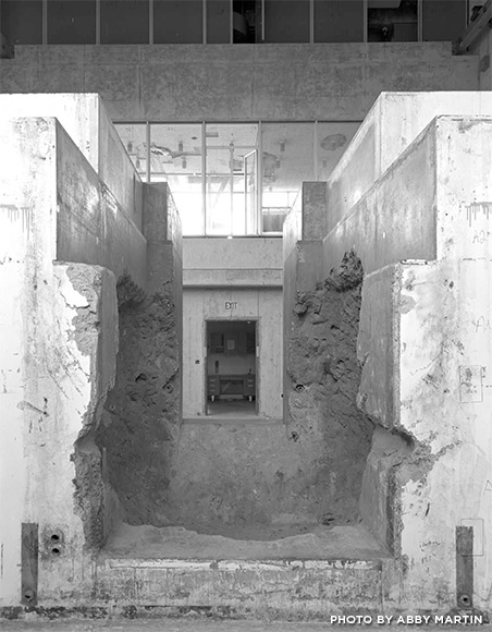 This is another photo by Abby Martin exposing the rough interior of the building. The building was built on the principles of brutalism in which rough concrete was the main focus.