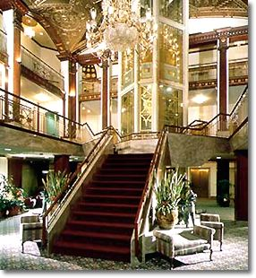 The hotel lobby is built around the glass elevator shaft and includes a historic plaque marking the high water mark of the 1938 hurricane.