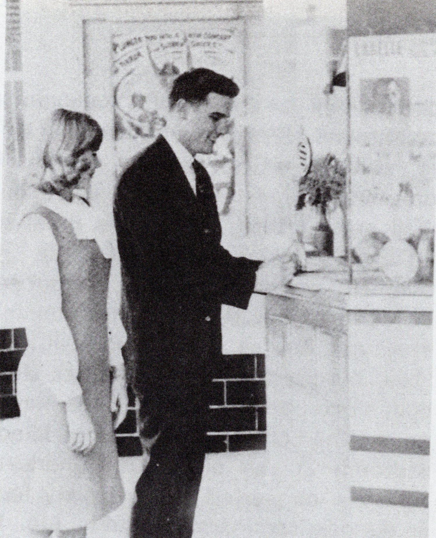 A couple purchases tickets at the LaBelle Theatre box office in 1964. Despite spending several decades as a church before being purchased by the city, the original box office remains.