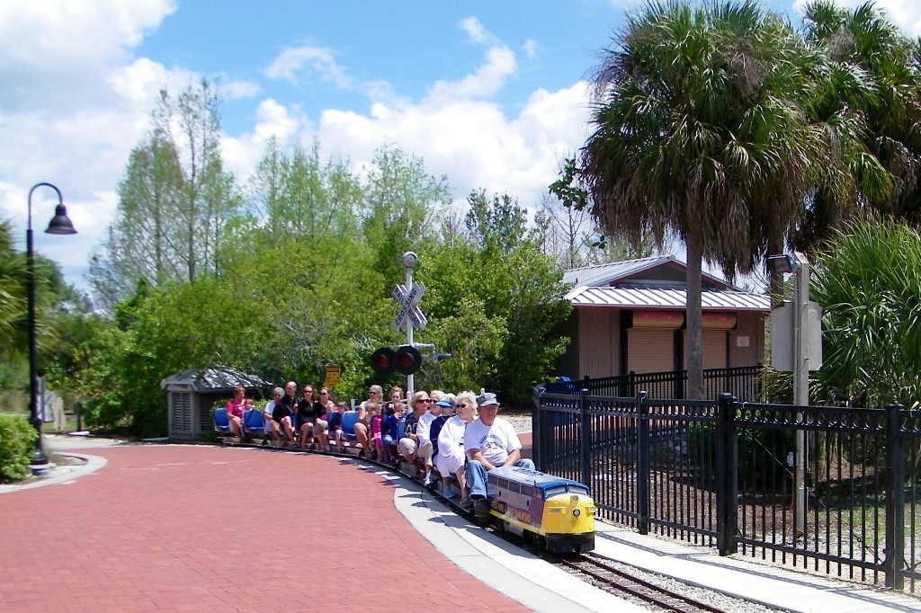 Riders enjoying the 15 minute ride on the scale model train