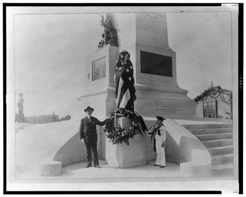 Taken in1903, an unidentified older gentleman and a boy in a sailor uniform stand in front of the Sherman Memorial during or after the unveiling.