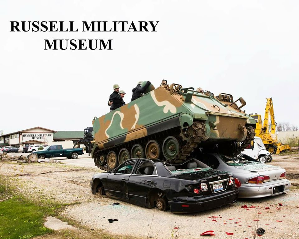 Track vehicle crushing cars at Russell Military Museum