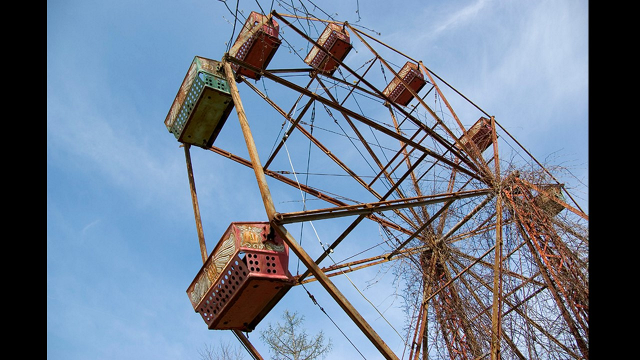 The rusted Ferris wheel is the most noticeable feature of the abandoned park.