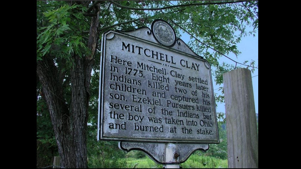 This sign provides a brief history of Mitchell Clay's family and the massacre of the two Clay children.