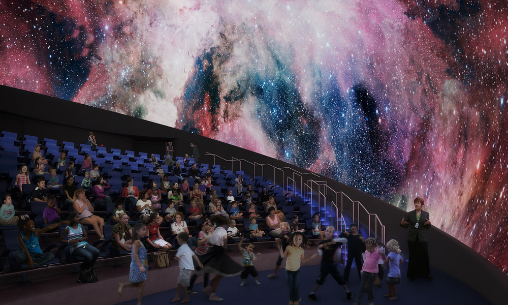Students view a presentation in the Frost Planetarium.