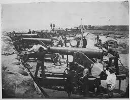 Members of the CSA Heavy Artillery man the fort's guns