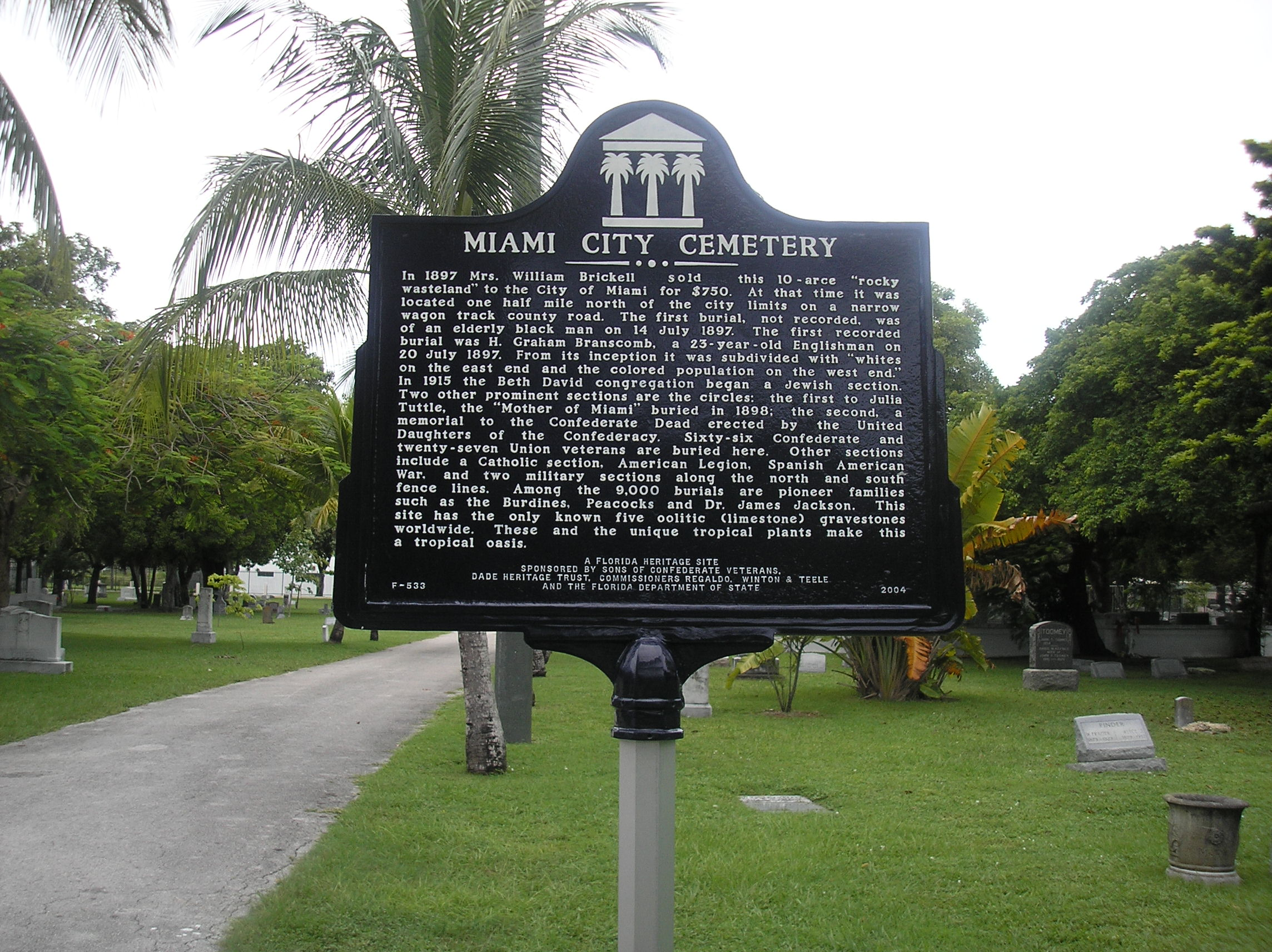 A historic marker for Miami City Cemetery, placed in 2013, notes important groups and individuals associated with the cemetery.