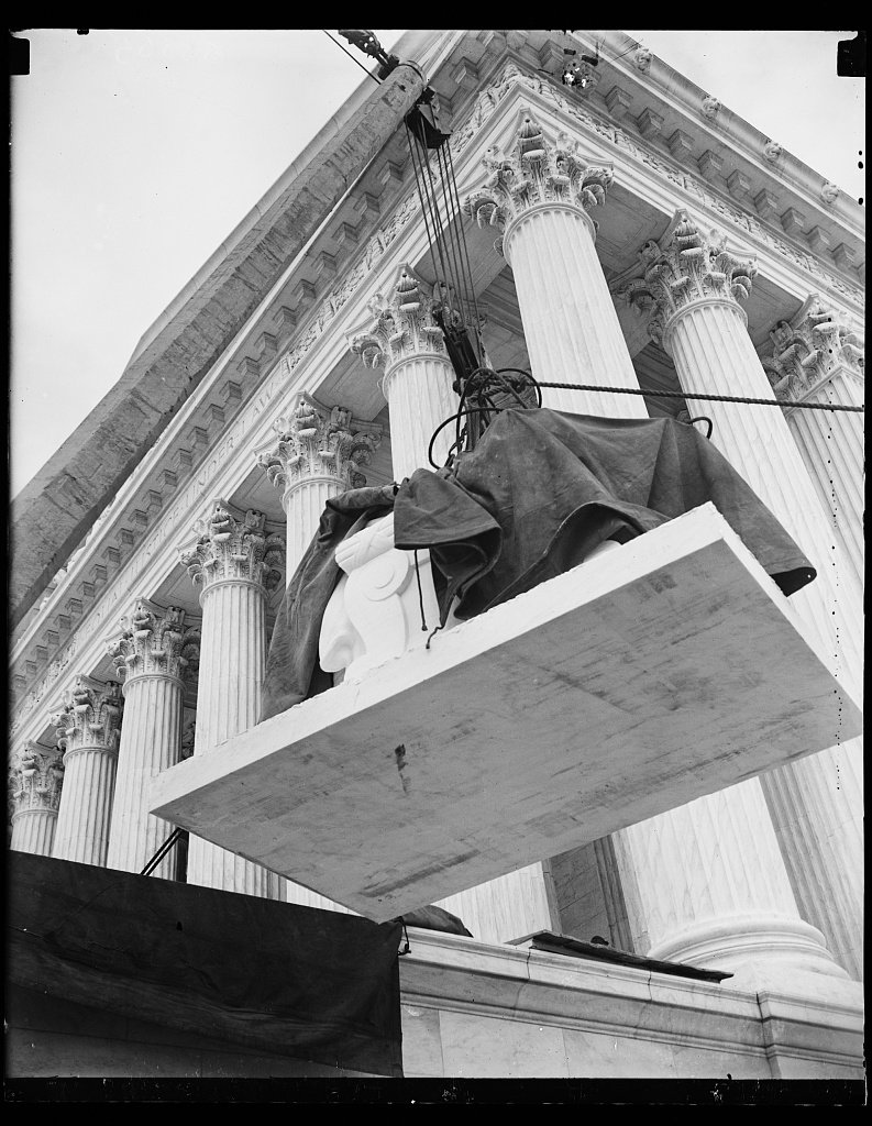 The first statue is placed outside the Supreme Court Building. Photo by Harris and Ewing, 1935, Library of Congress.
