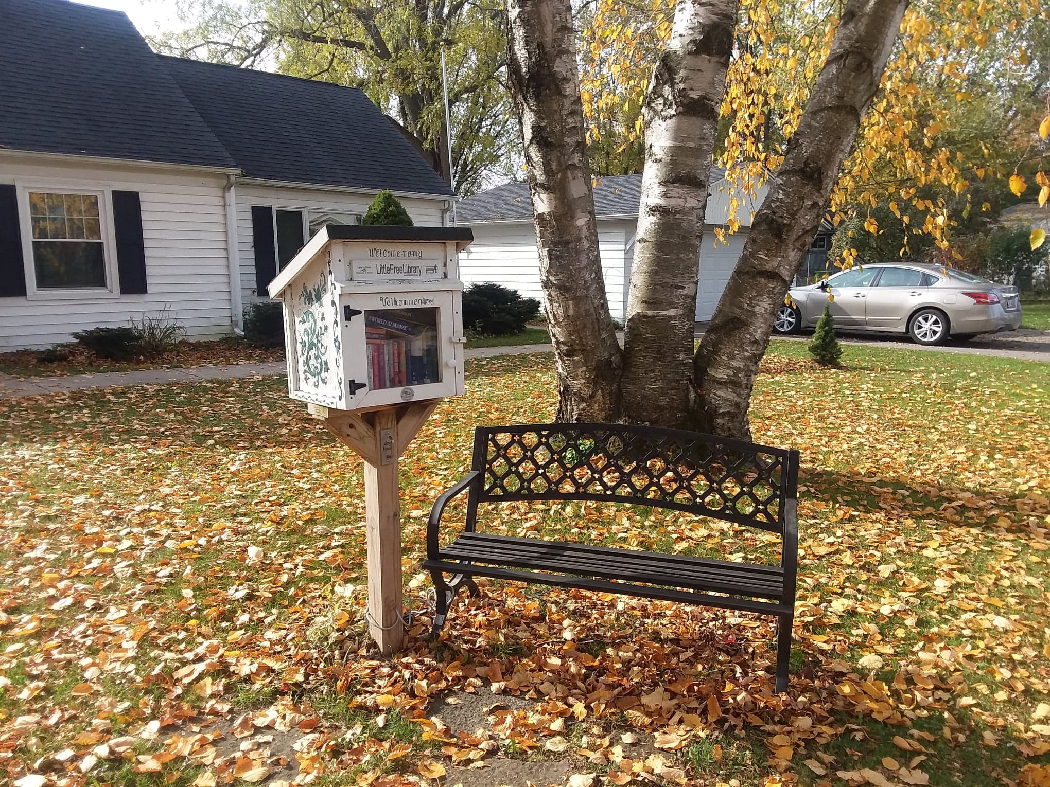 Little Free Library and Bench located at 205 Davidson Street in Madison, WI.