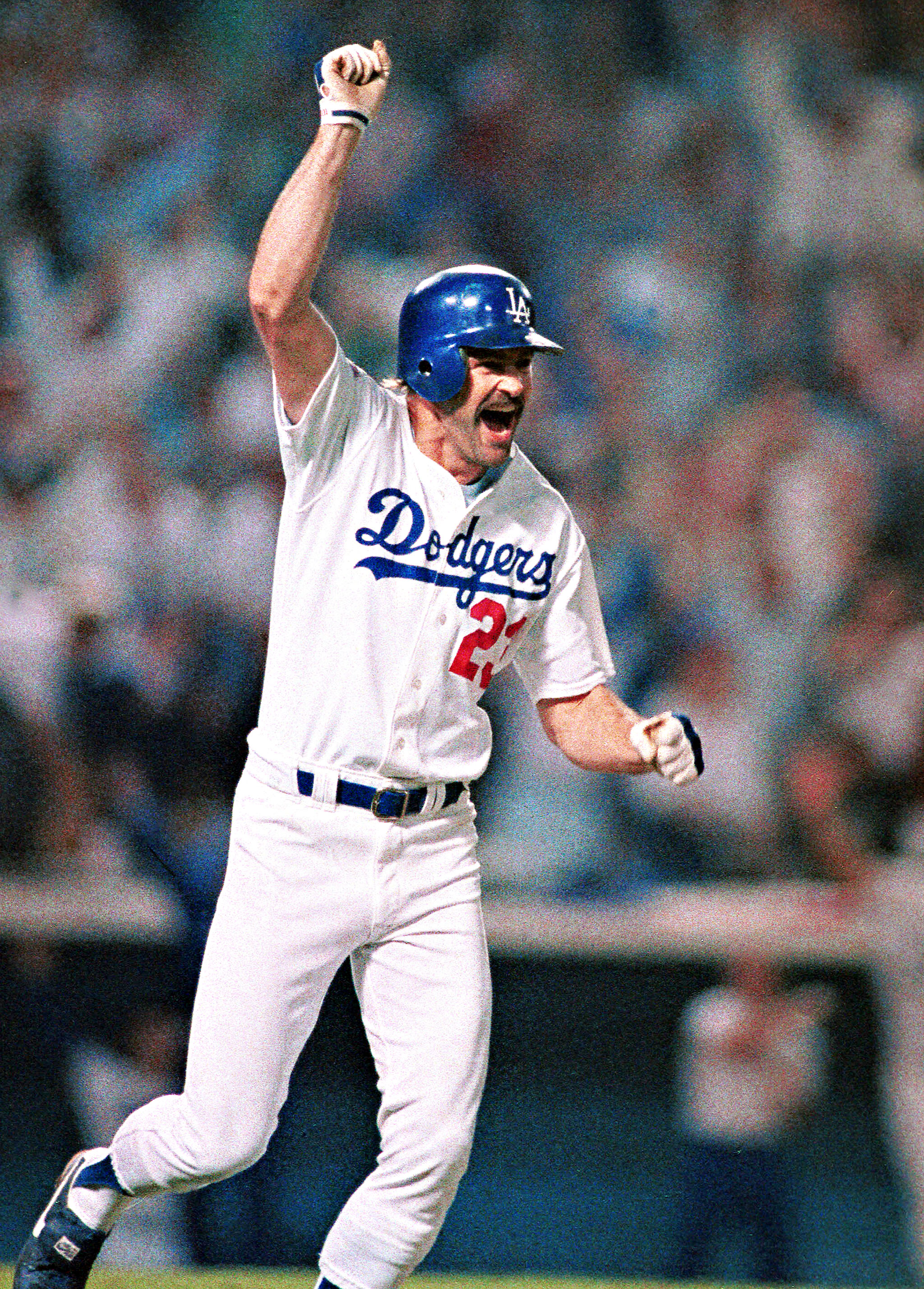 Kirk Gibson celebrating his walk-off homerun in Game One of the 1988 World Series (look at that mustache)