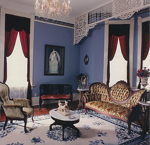 A restored parlor within Falcon Rest.