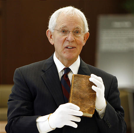 LDS Church Official Historian Elder Marlin K. Jensen holds a first edition of the Book of Mormon