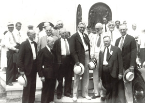 Dedication of Angel Moroni Monument in 1935. President Heber J. Grant is located right-middle. He is in a white suit, dark tie, holding a white hat in left hand. White beard and glasses, he is looking down.