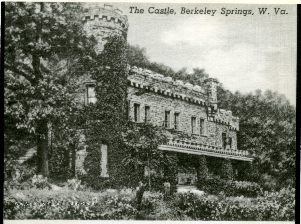 Photo ca. 1920-1930. The severely overgrown foliage suggests minimal maintenance and use of the building
