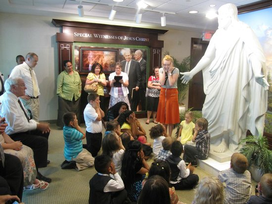 Missionaries assigned to visitor center teach kids about Christ.