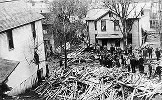 Corner of Tenth and Avery Street. View of the wreckage caused by tanks.