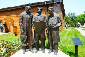 Statue in front of the tabernacle depicting the new First Presidency mapping out the encampments of the church in the area. L-R: Heber C. Kimball, Brigham Young and Willard Richards