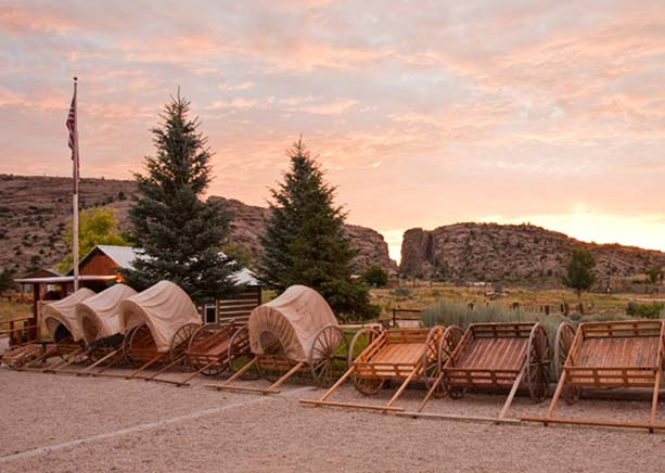 Replica handcarts for tourists with Devil's Gate in background