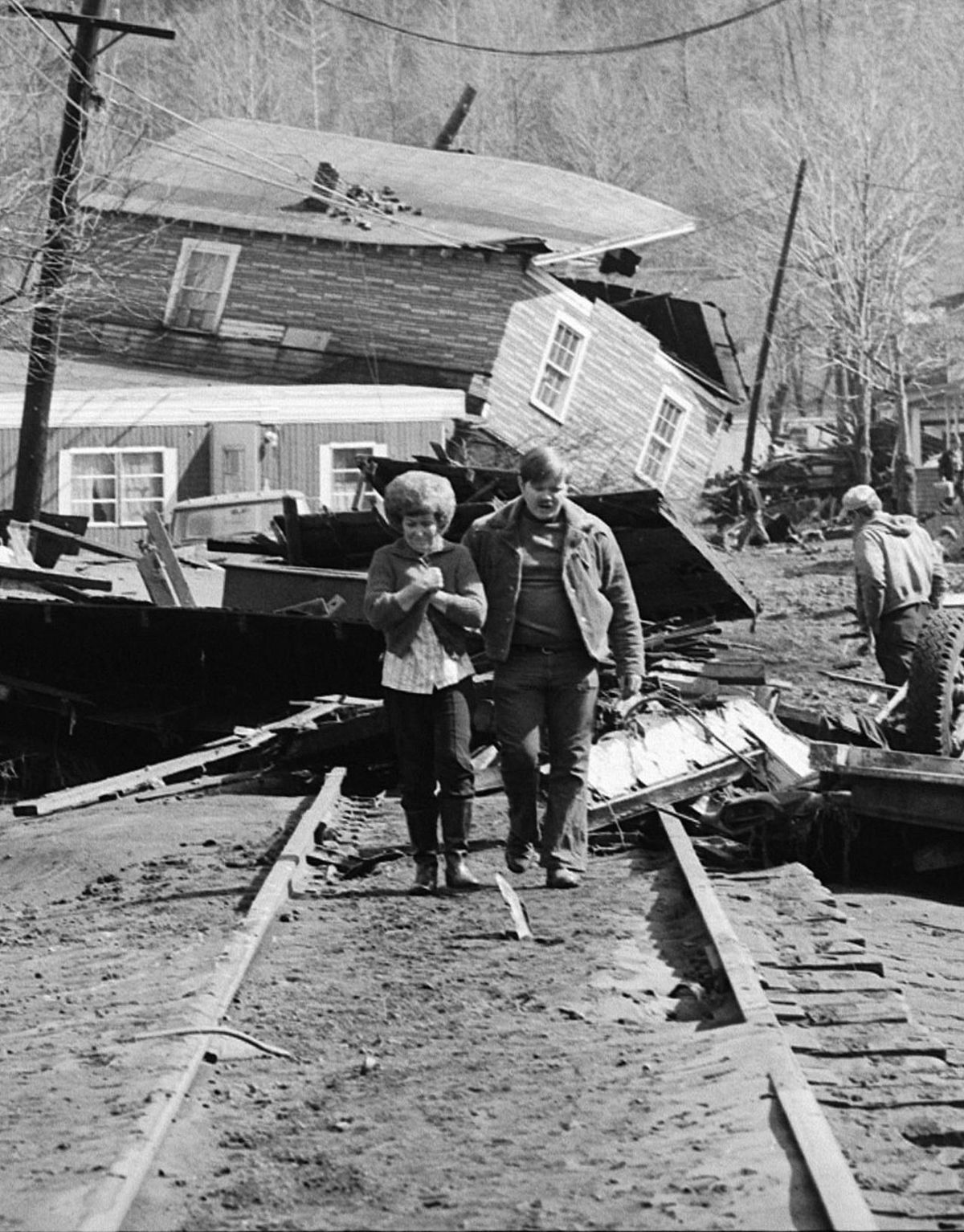 People after the flood.  It destroyed railroad tracks also, as you can see.