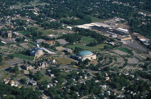 Aerial view of Temple Lot: Community of Christ temple and auditorium: largest buildings. Church of Christ's building is the small white sided one in between the former. The LDS visitors center is the rectangular one near rounded top structure.