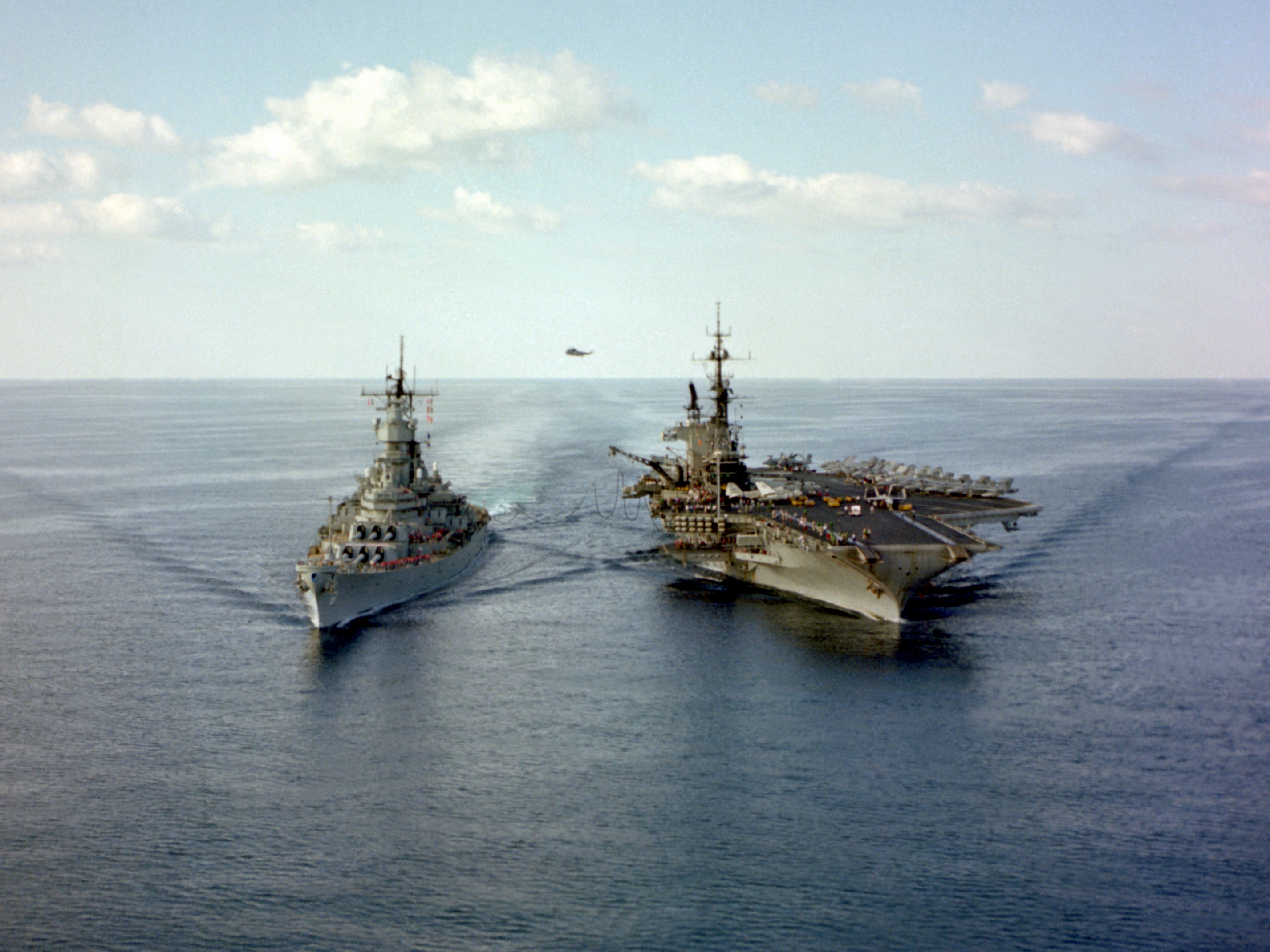 USS Iowa alongside the aircraft carrier USS Midway in 1987.