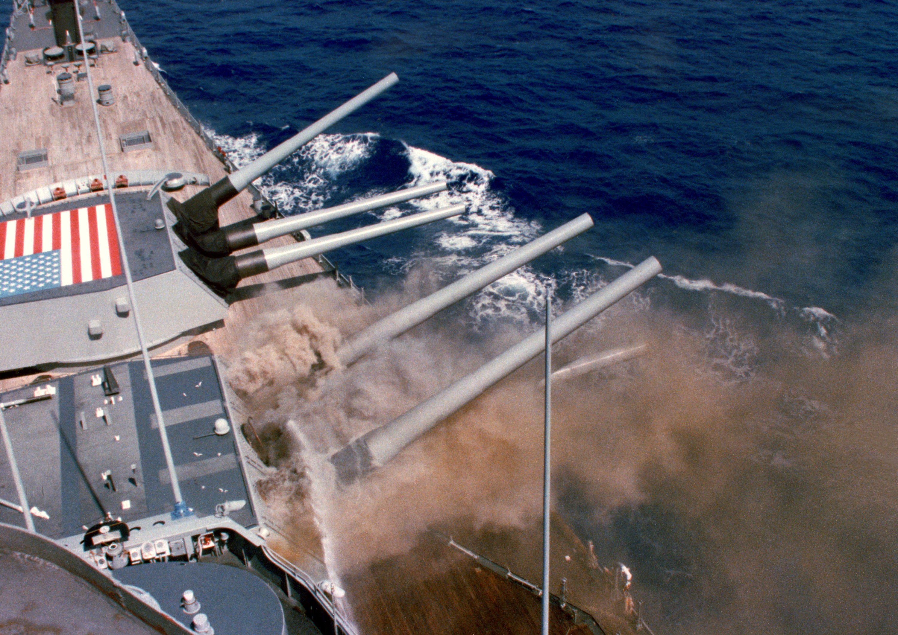 The damaged Number Two turret smokes while being cooled with seawater shortly after the 1989 explosion.