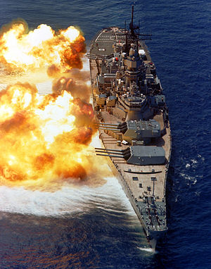 View of USS Iowa firing her main guns.