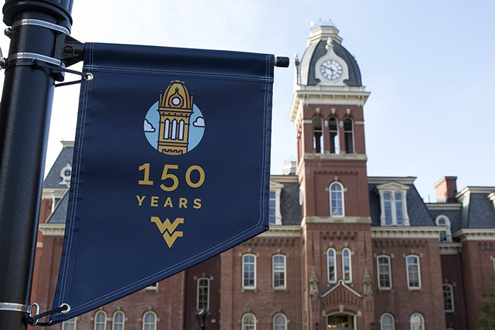 Woodburn Hall's iconic bell tower serves as the logo for celebrating WVU's 150th. Photo courtesy WV Metro News.
