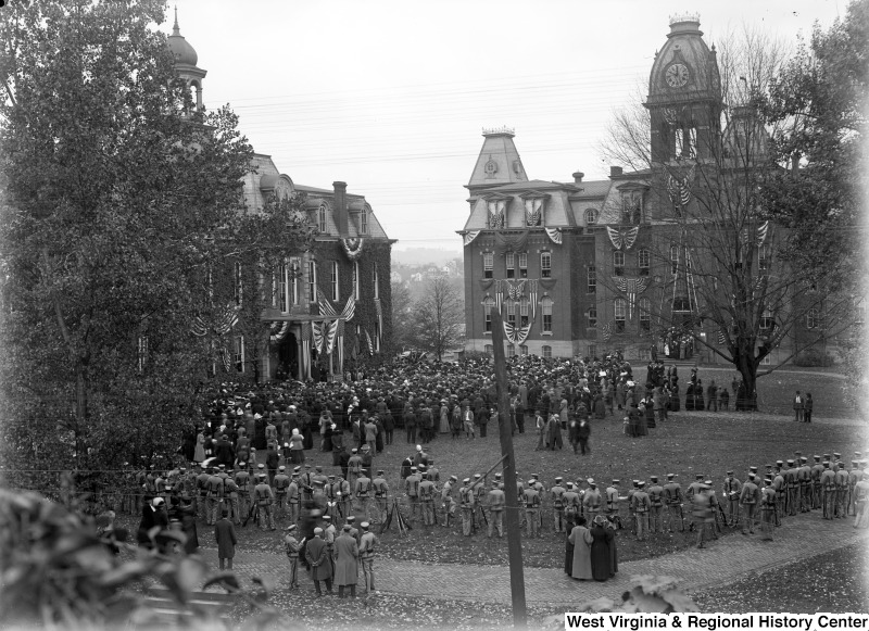Crowds gather outside Woodburn Circle to welcome United States President William Taft in 1911. Patriotic banners adorn Woodburn Hall and its neighbor, Martin Hall.