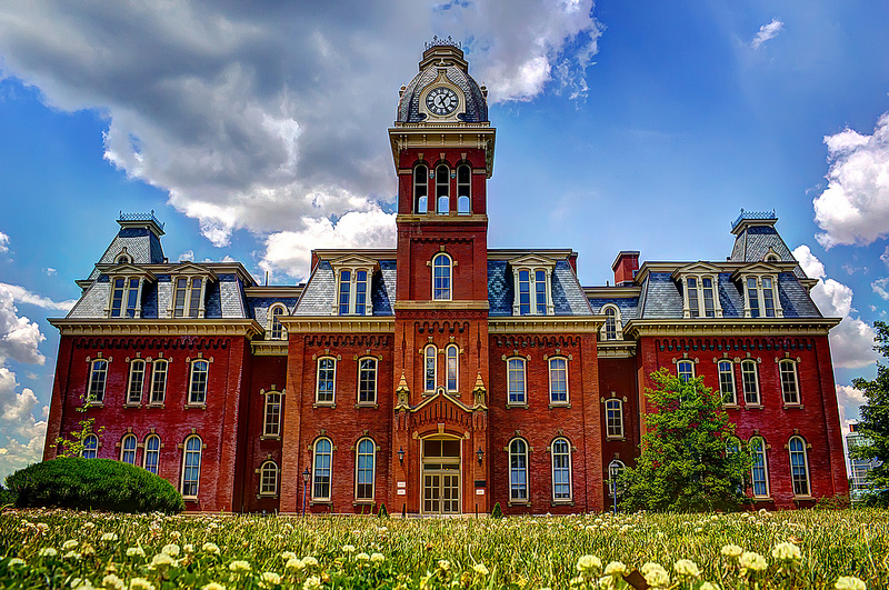 Woodburn's red brick, Mansard roof, and bell tower are beautiful examples of the Second Empire architectural style.