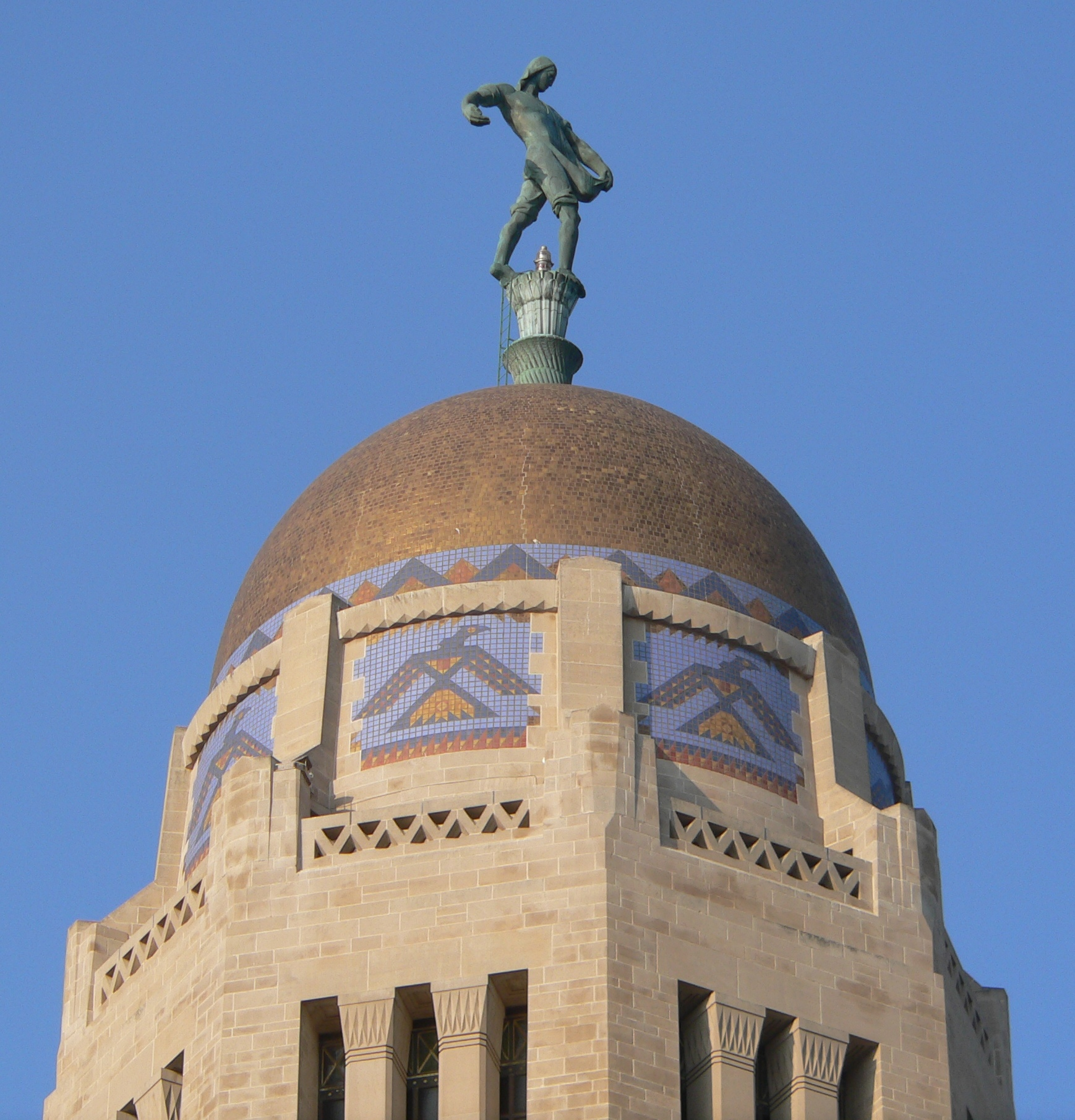 "View of Nebraska State Capitol dome with statue ""the Sower"" in 2012 (Ammodramus)"