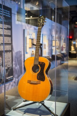 "Paul Simon's guitar on display at the Jewish Museum of Maryland as part of the traveling Rock and Roll Hall of Fame exhibit, ""Paul Simon: Words and Music."""