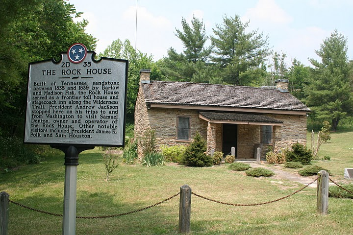 Rock House with historical marker in the foreground.