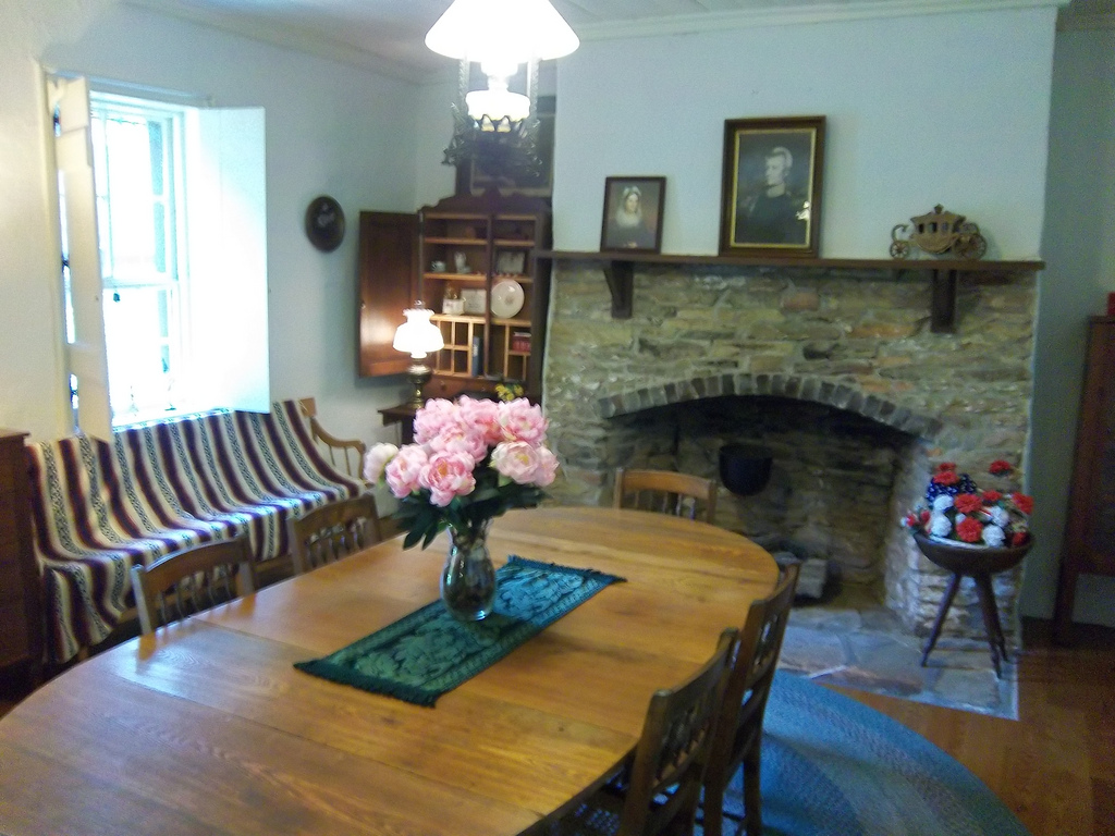 Interior of the Rock House with period furniture and a picture of Andrew Jackson on the mantel.